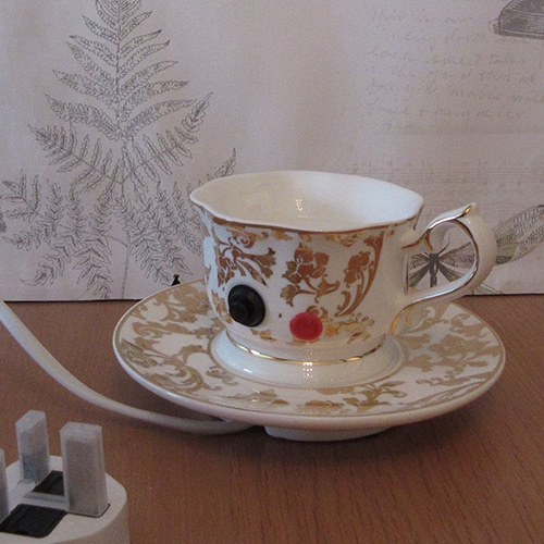 back of scentsy teapot warmer